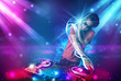 Energetic Dj mixing music with powerful light effects - 58464548