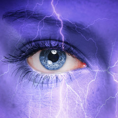Woman face with thunderstorm painted on it - nature concept