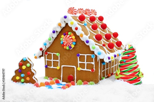 In de dag Dessert Gingerbread house in snow isolated on white