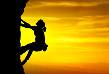 Rock climber on the sky background. Sport and active life