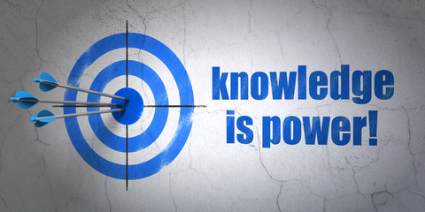 Education concept: target and Knowledge Is power! on wall