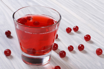drink of fresh cranberries in a glass on a wooden table