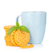 Stack of crackers with mint and cup of drink