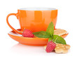 Cup of drink with crackers, mint and berries