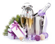 Christmas champagne with alarm clock in bucket and gift box