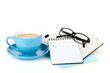 Blue coffee cup, glasses and office supplies