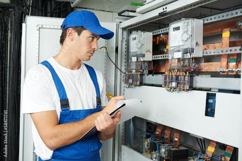 Leinwanddruck Bild electrician worker inspecting