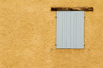 Shutter on wall. Provence. France.