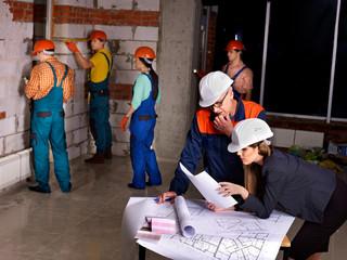 Business group people in builder helmet .