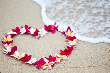 Flower love symbol on sand