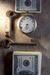 Key to Financial Success. Money, keys, pocket watch.