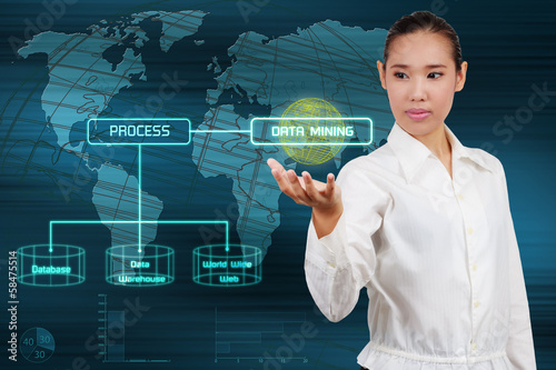 Data mining concept - business woman show virtual screen