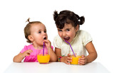 little girls drinking orange juice