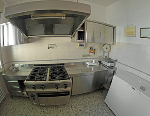 stainless steel industrial kitchen for preparing meals with a bi