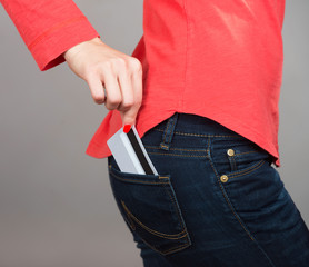 Close-up shot of a credit card in pants pocket