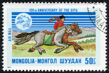 a stamp printed in the Mongolia shows Mongolian dispatch rider