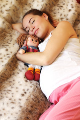 Sleeping pregnant woman on the bed