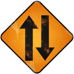 Two way traffic sign. Damaged yellow metallic road sign with Two