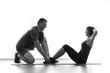 Woman does situps with coach
