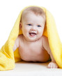 Adorable happy baby in towel