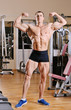 Bodybuilder posing at gym