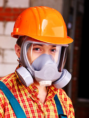 Man in builder respirator.