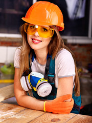 Woman in builder respirator.