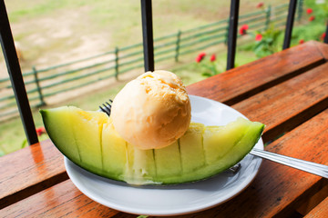 Cantaloupe, fresh from the garden and  Ice cream