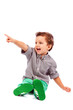Adorable little boy pointing at something
