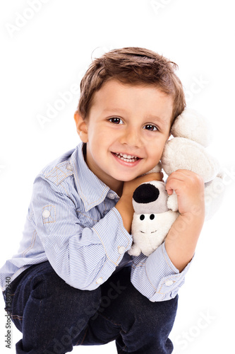 Adorable little boy holding  his favourite toy