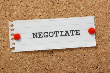The word Negotiate on a cork notice board