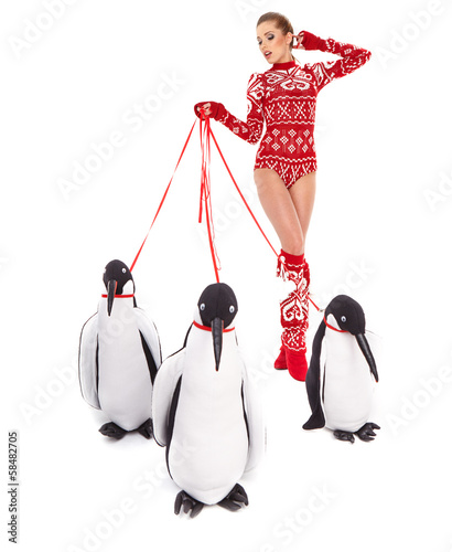 Winter woman walking with penguins