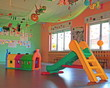 slide and plastic tunnel in the playroom