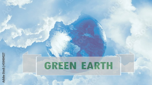Green earth - planet in blue sky, white clouds.