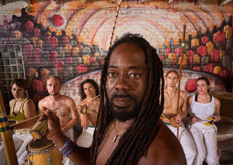 Handsome Capoeira Master with Instruments