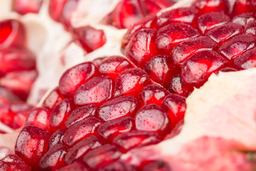 Pomegranate with its seeds close-up