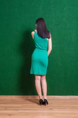 backside shot of the brunette lady