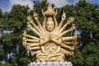 Golden buddha with many arms