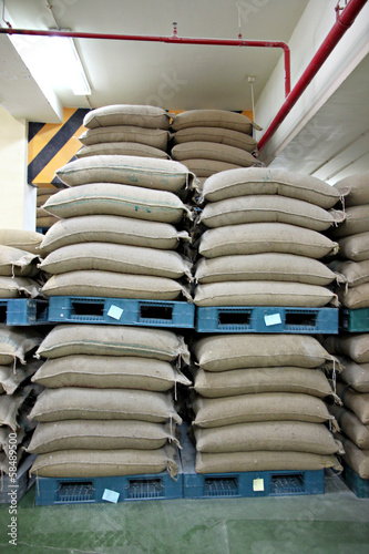 Stacked of Rice sacks in warehouse.
