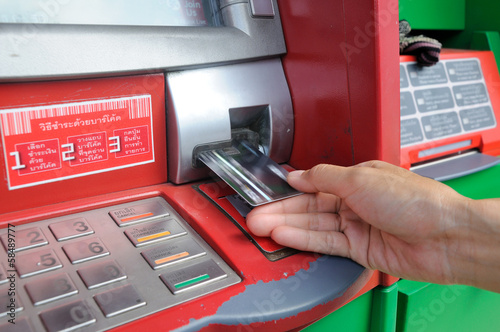 insert card into an ATM to begin a financial transaction