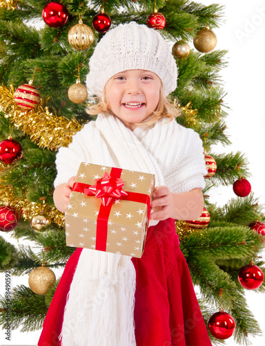 The portrait of the little child smiling and holding present box