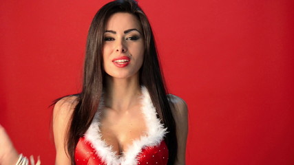 Sexy Brunette Woman in Red Christmas Outfit Posing Isolated