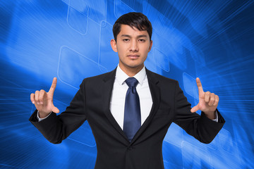 Composite image of unsmiling businessman holding