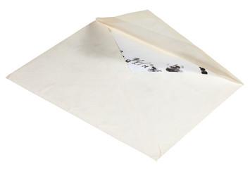 open paper envelope with children letter