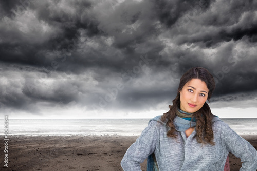 Composite image of serious pretty brunette wearing winter clothe