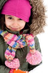 Cute little girl making a snowman