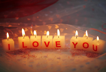 Candles with printed sign I LOVE YOU,on  color fabric