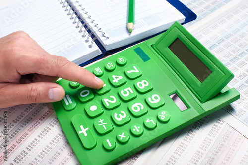 Hand of businessman with calculator.