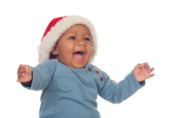Adorable african baby with Christmas hat shouting