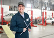 Auto mechanic with wrench.